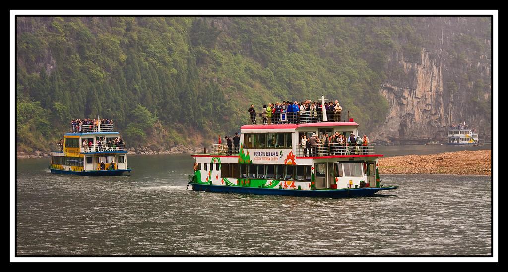 IMAGE: https://photos.smugmug.com/Travel/CHINA-FOCUS-TOUR-2010-LI-RIVER/i-Kq7DWtL/0/1426df50/XL/0903%20two%20tour%20boats-XL.jpg