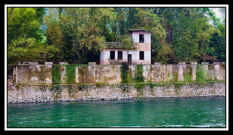 House on river bank...