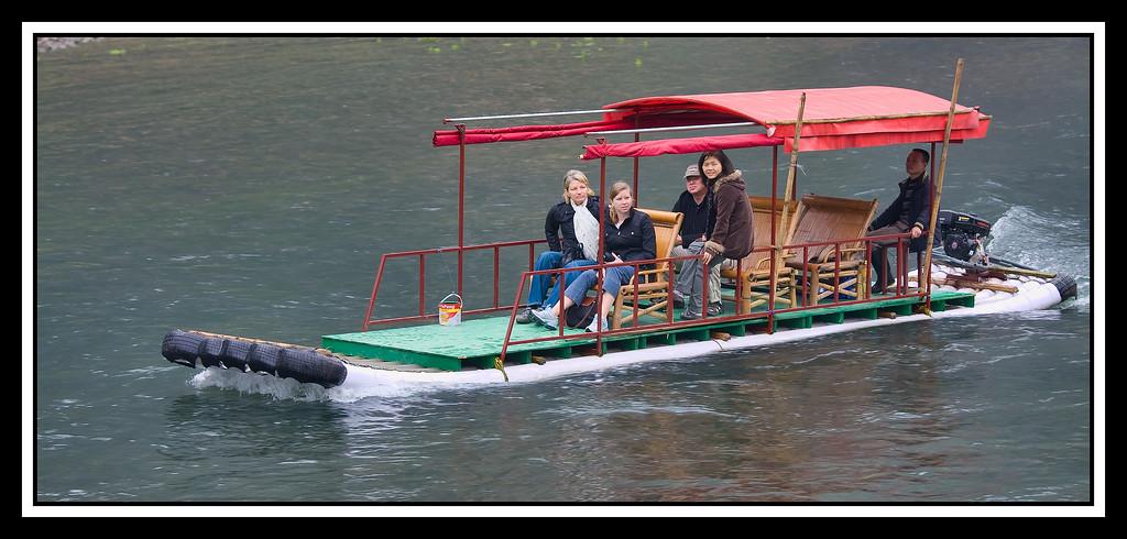 IMAGE: https://photos.smugmug.com/Travel/CHINA-FOCUS-TOUR-2010-LI-RIVER/i-gPZZnvm/0/069215d6/XL/0999%20small%20tour%20boat%20with%20white%20pax-XL.jpg