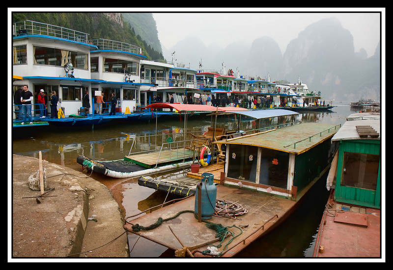 Different types of tour boats moored...