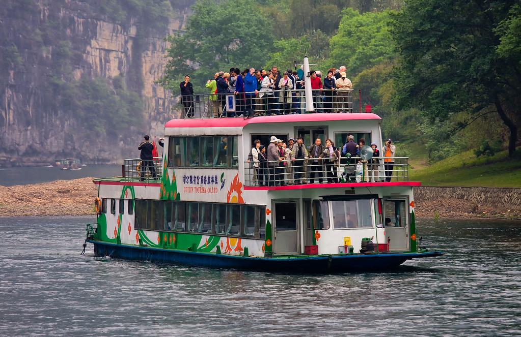 IMAGE: https://photos.smugmug.com/Travel/CHINA-FOCUS-TOUR-2010-LI-RIVER/i-scs7b67/0/9f4d2032/XL/Li%20River%20tour%20boat%20master%2001-XL.jpg