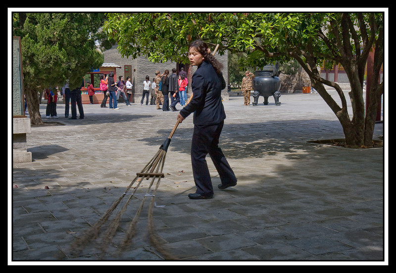 Sweeping area with enormous broom...