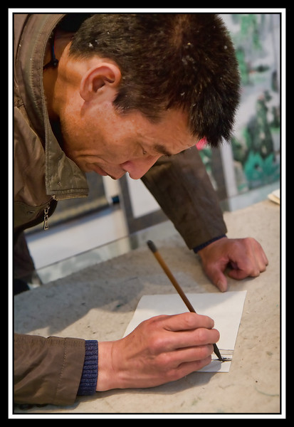 Artist at work doing caligraphy...