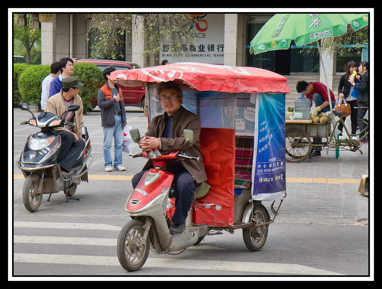 IMAGE: https://photos.smugmug.com/Travel/CHINA-FOCUS-TOUR-2010-XIAN/i-7hV2qxc/0/c3c35703/X2/0848%20%20Street%20Scene%20motorcycle%20taxi-X2.jpg