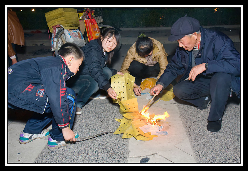Quing Ming - burning offerings to ancestors...