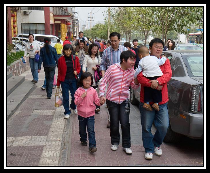 Pedestrians outside restaurant...