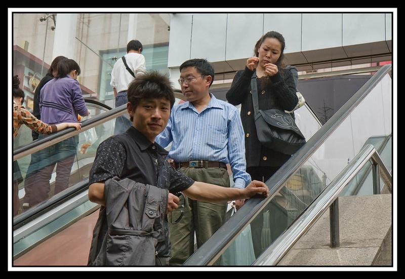 Escalator to subway street underpass crossing...