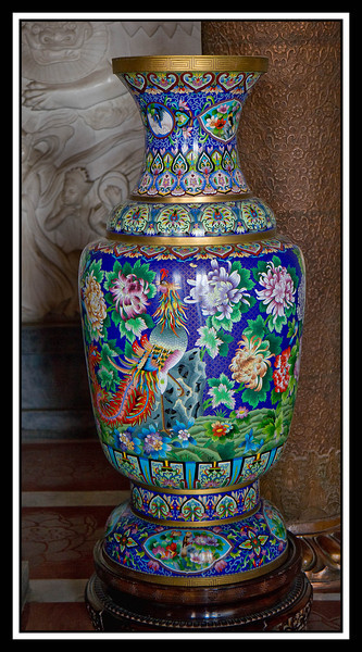 Vase next to Budda statue in temple...