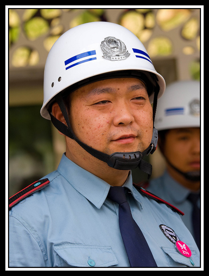 IMAGE: https://photos.smugmug.com/Travel/CHINA-FOCUS-TOUR-2010-XIAN/i-rm5W4Ps/0/9fa35e86/X2/A%200402%20Security%20guard-X2.jpg