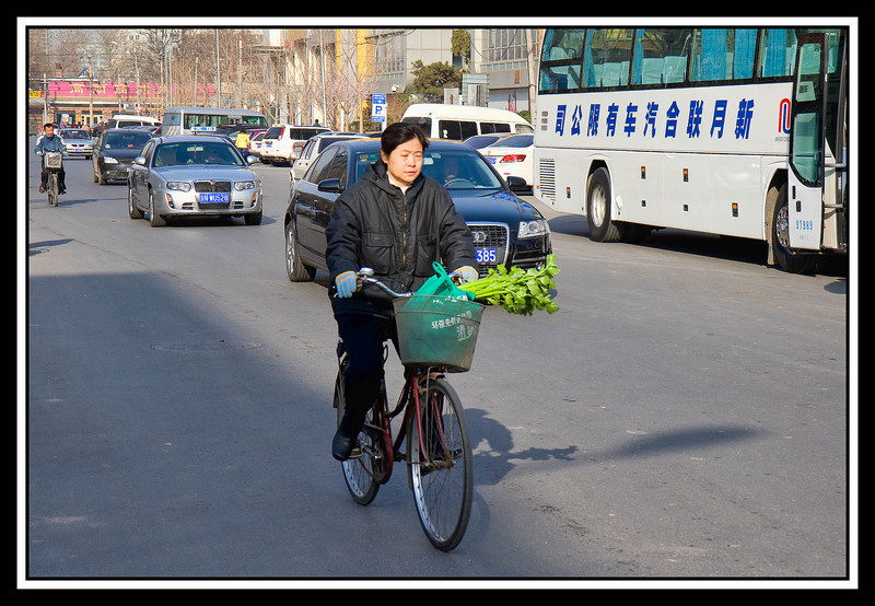 Morning traffic in front of Holiday Inn Express, Beijing...