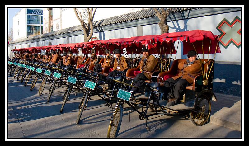 """Pedicab (incorrectly called """"rickshaws"""") lineup at Hutong Tour..."""