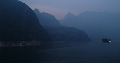 China. Scenes from the Yangtze river. Just before dawn. My first glimpse of the mountains of the Three Gorges.