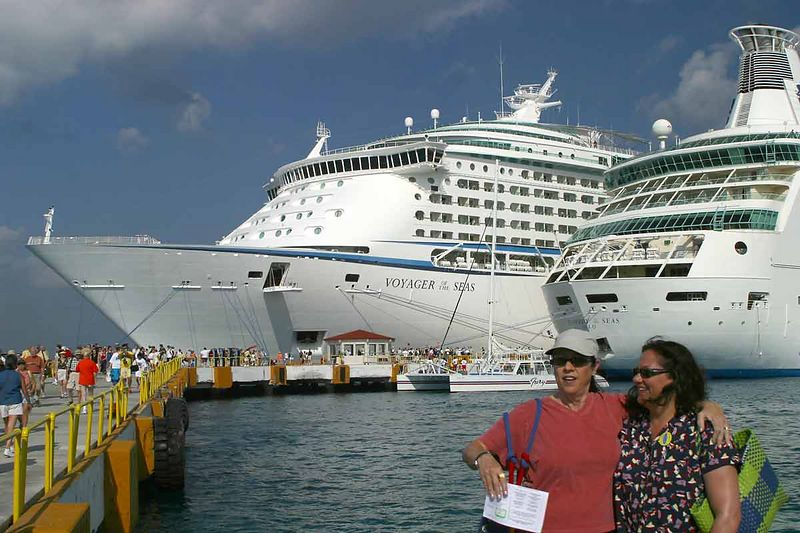 VOYAGER(LARGEST CRUISE SHIP IN THE WORLD) NEXT TO THE RHAPSODY IN COZUMEL