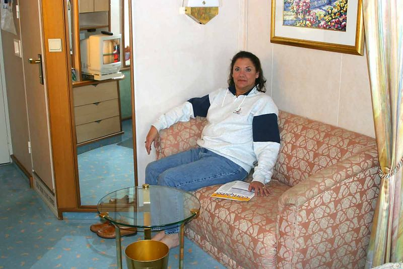 KIM SITTING ON COUCH IN STATEROOM