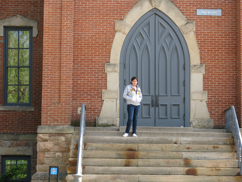 Marissa on the steps of Old Main building.