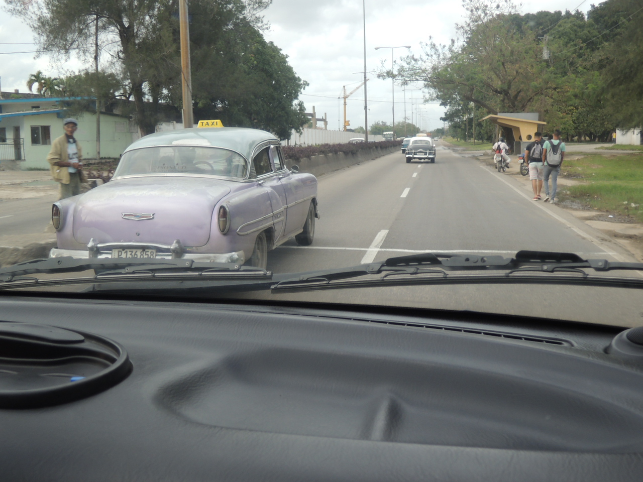 A 53 Chevy following an early 50's Chevy or Pontiac in the distance as we head in from the airport.  We were riding in a fairly new Hyundai mini-van that had a diesel engine and a manual transmission.