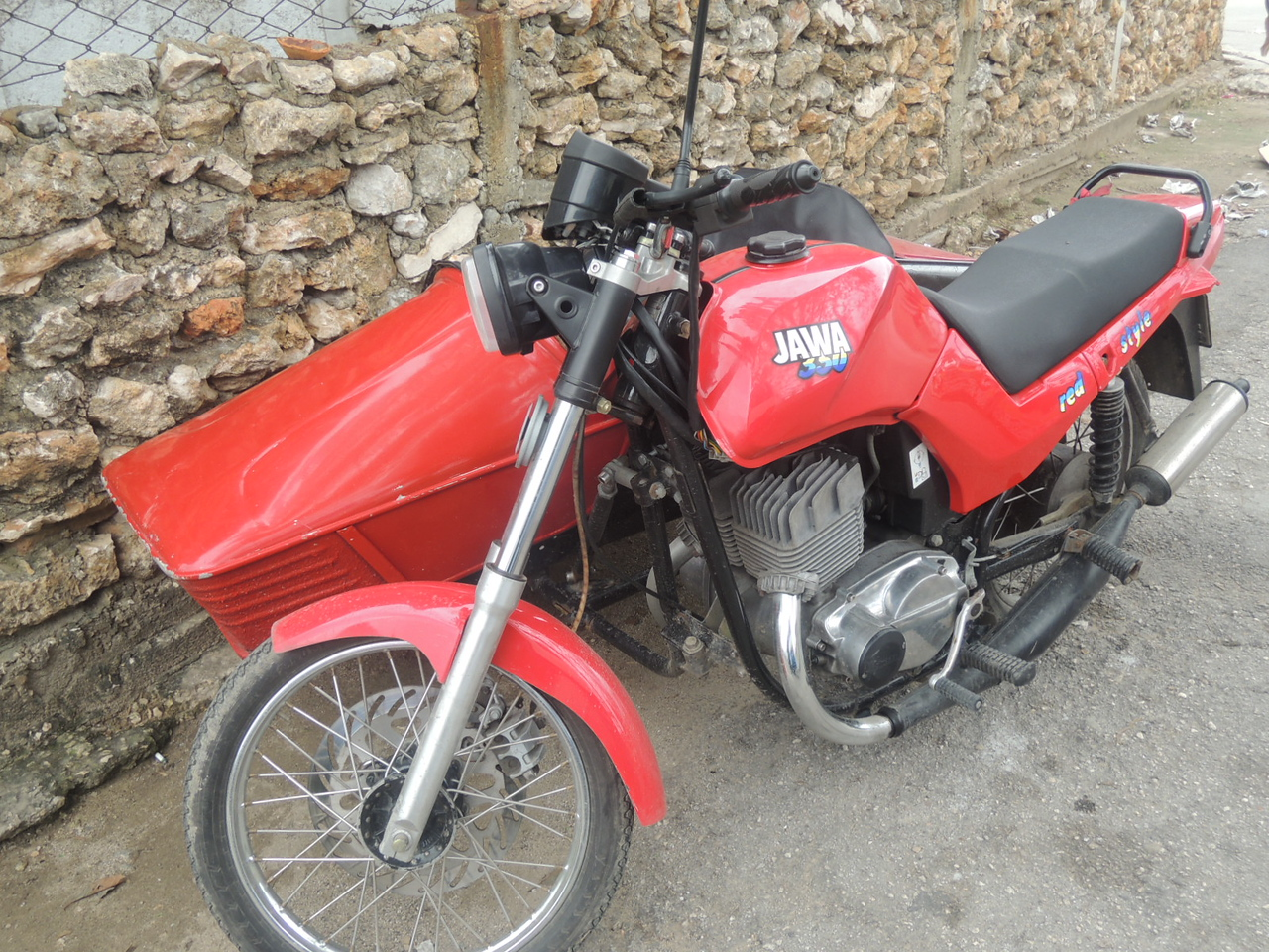 A 350 Jawa with a sidecar and the only expansion chamber exhaust system I saw in Cuba.