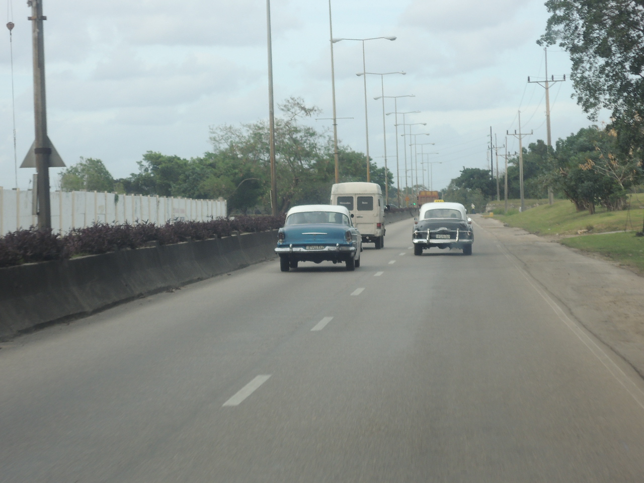 Looks like about a 53 or 54 Plymouth there on the left.