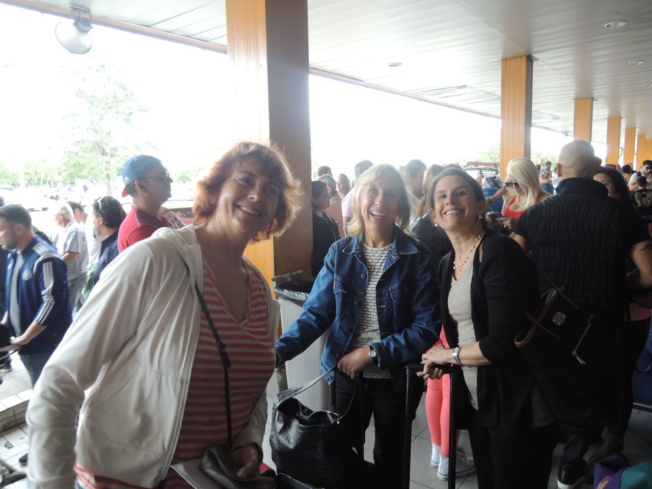 Kathleen, Patty, and Elaine in the mob scene outside the airport terminal.