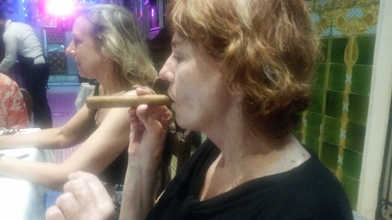 Kathleen smoking a cigar - a sight never before seen.