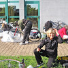 Monna unpacking her bike with a group of others at the Kyriad Hotel at the Lyon airport.