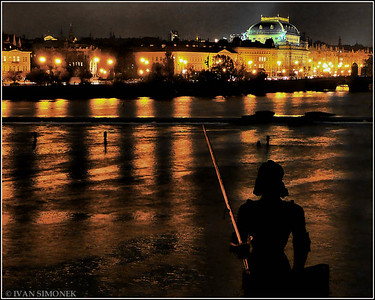 """WAITING LEGEND"",statue of knight Bruncvik looking over the Vltava river toward the National Theatre,Prague,Czech Republic."