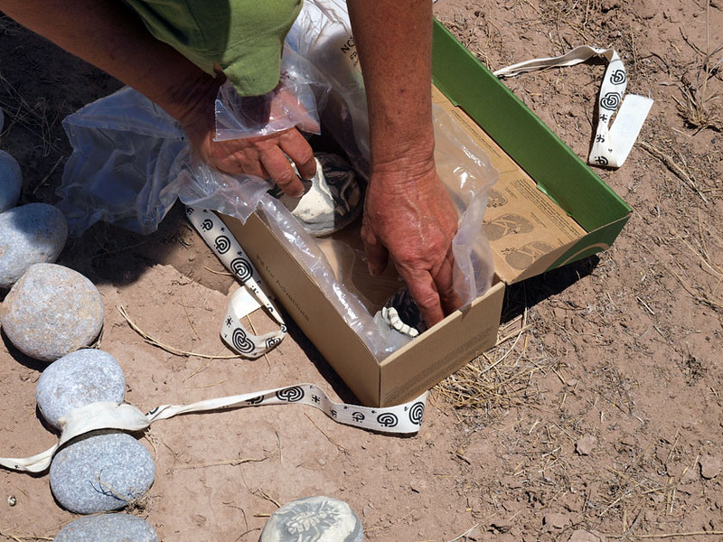 Beth unpacks cremains from coffin box in preparation for installation