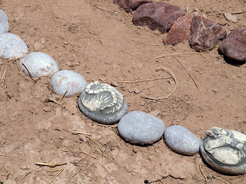 Grasshopper and centipede cremains installed in Graveyard labyrinth