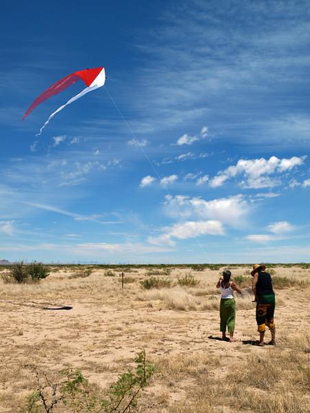 Beth helps Cordelia haul in Ghost kite in high winds