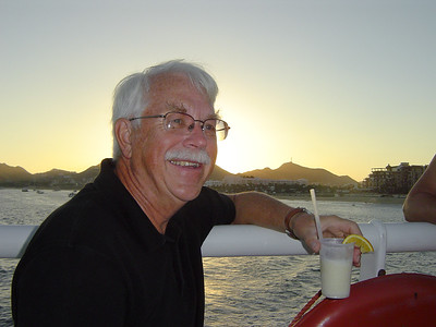 Dad enjoying a drink on the Caborey sunset dinner cruise