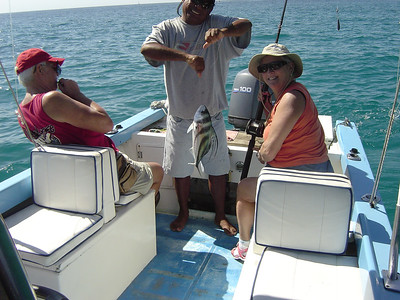Mom caught a Rooster fish on Ponga boat