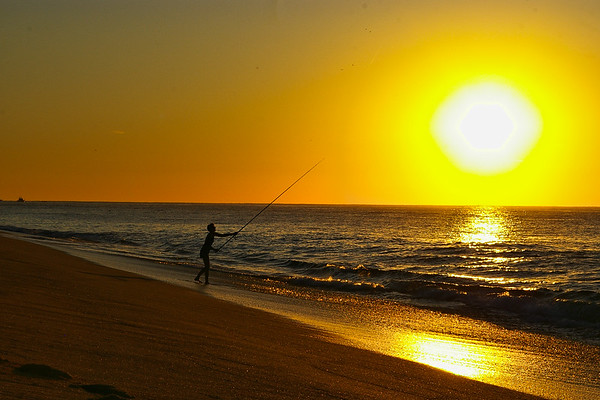 Sunrise fishing on Pacific Ocean beach.  Playa Grande resort