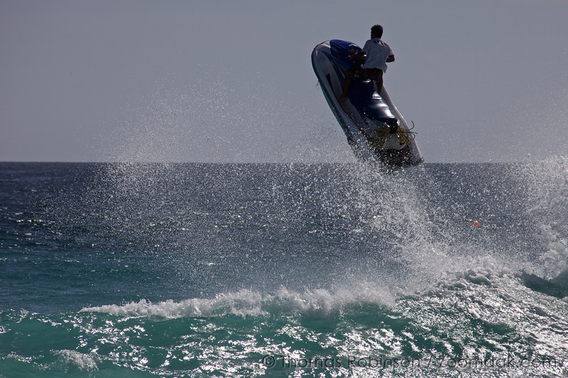 A jet skier flies over a wave-crest along the shores of the Baja, Pennisula in Mexico.