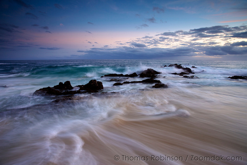 Cabo Seascape: Waves roll in and around the rocks after sunset on the shores of the Baja Peninsula, Mexico.