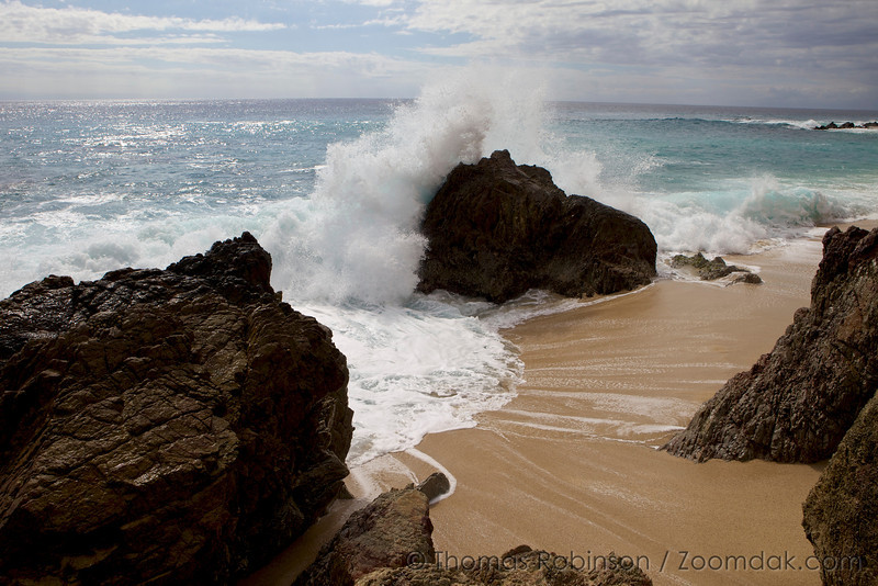 Cabo Seascape: A wave crashes over the Mexican coastline on the shores of the Baja Peninsula, Mexico.