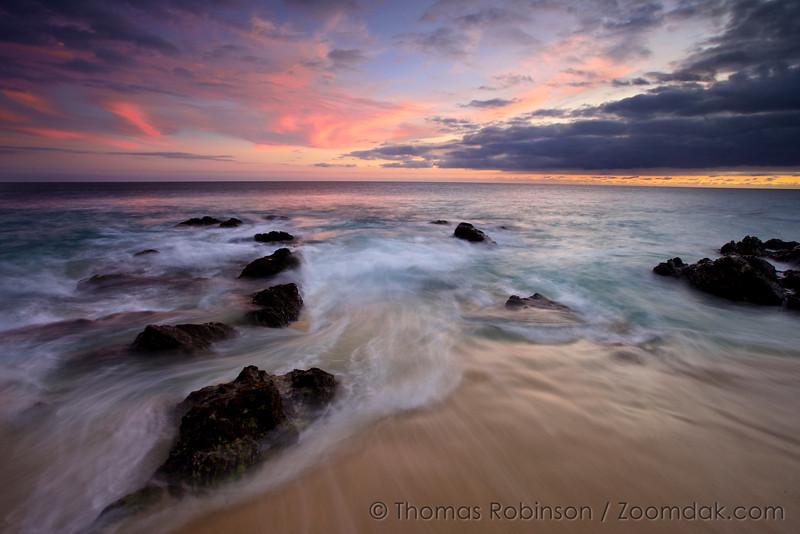 Cabo Tides Turning: Waves roll in and around the rocks after sunset on the shores of the Baja Peninsula, Mexico.