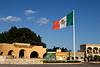 The Mexican Flag flaps in the wind in the main plaza in San José del Cabo, Mexico. (Jardin del los Cabeños Ilustres y Tte, Jose Antonio Mijares)