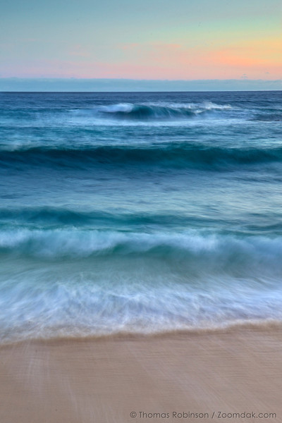 Cabo Wavescape: Waves roll in and out at twilight on the shores of the Baja Peninsula, Mexico.