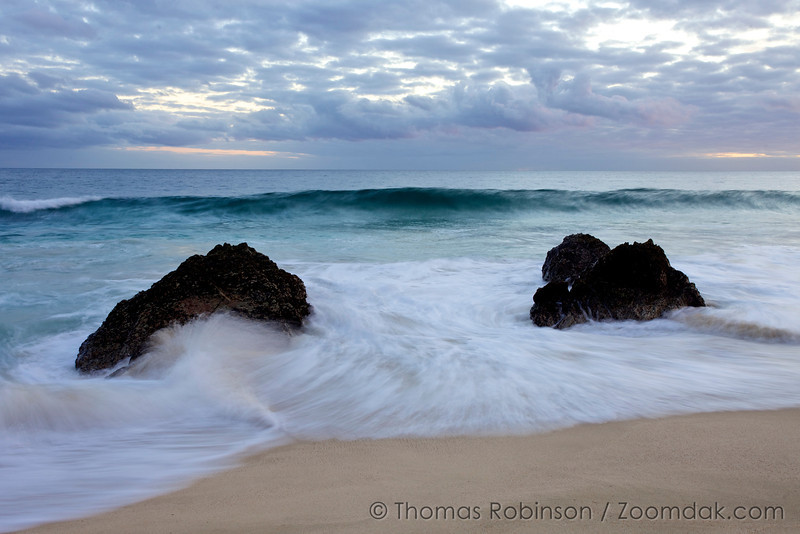 Cabo Elements of Nature: Waves roll in and around the rocks after sunset on  the shores of the Baja Peninsula, Mexico.