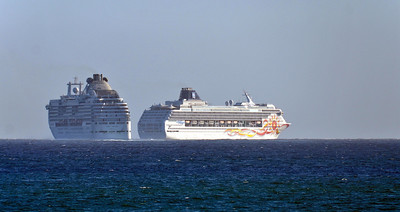 Two cruise ships departing Cabo San Lucas around sunset, May 10th 2014.