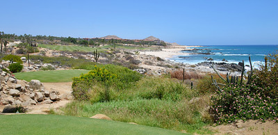 View from the Tee of #18 at Cabo del Sol Ocean Course.  The goal is to place your tee shot out the to left... not to the right on the beach... guess where I put mine?