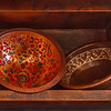 Three hand beaten copper sinks.