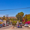 Main street, Todos Santos. The famous Hotel California is on the right just beyond the bright red bougainvillea.