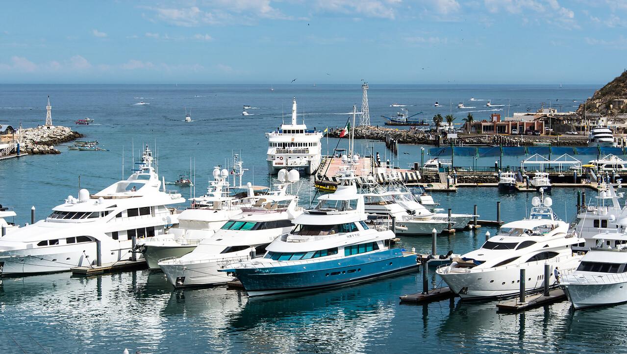 View from my balcony of fishing boats heading back to marina, Cabo San Lucas - January 2015