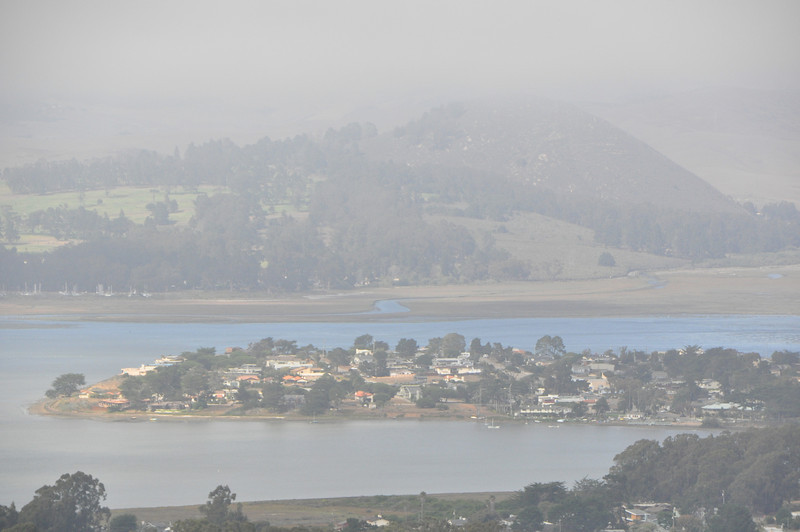 The Morro Bay campgrouns is in the distance on the far side of the bay.  The penninsula is Baywood Park.
