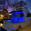 Blue lit boat; Cairns Yacht Basin, Queensland