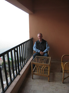 Colin enjoying the balcony with its view of the Nile, even though it was foggy.