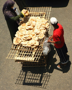 Pitta bread seller on a cairo street.