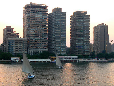 "Nile / City view of ""upmarket"" residential buildings at sunset."