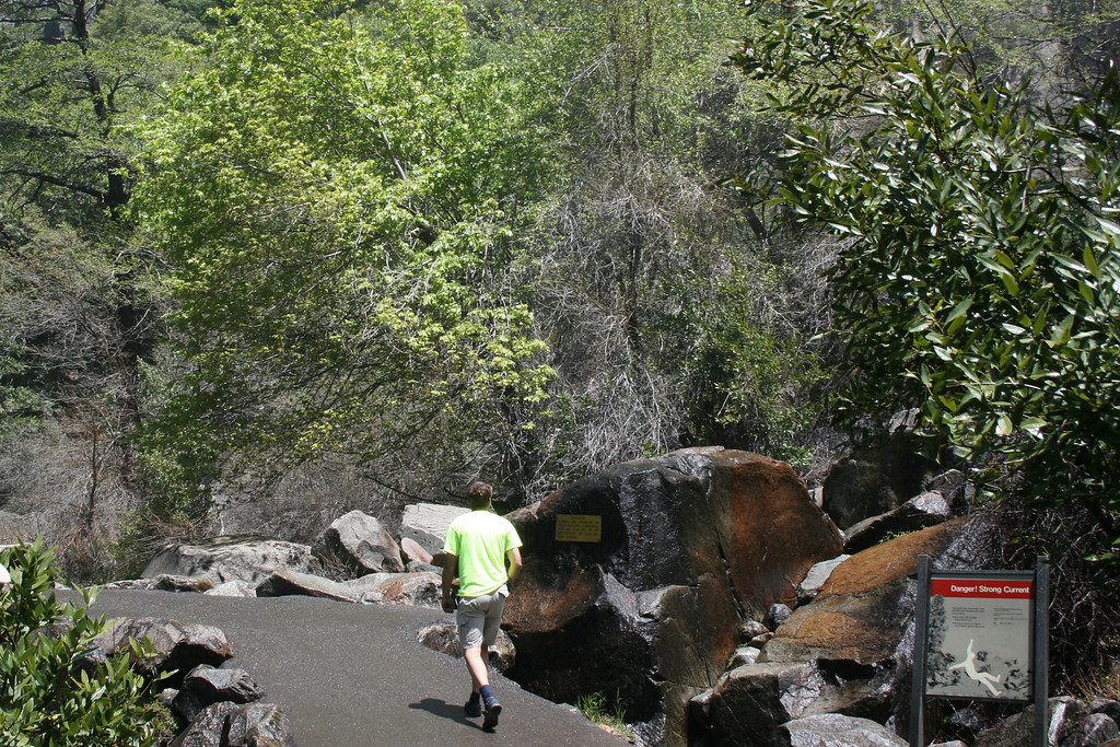 The trail and the big rock on the left are damp from the spray of Bridalveil Fall.